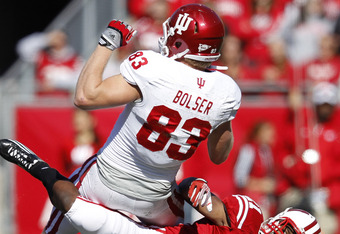 MADISON, WI - OCTOBER 15: Peniel Jean #21 of the Wisconsin Badgers makes a tackle against Ted Bolser #83 of the Indiana Hoosiers at Camp Randall Stadium on October 15, 2011 in Madison, Wisconsin. The Badgers won 59-7. (Photo by Joe Robbins/Getty Images)