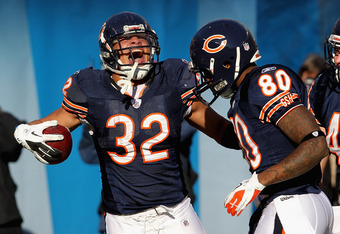 CHICAGO, IL - DECEMBER 18:  Kahlil Bell #32 of the Chicago Bears celebrates a touchdown catch with Earl Bennett #80 against the Seattle Seahawks at Soldier Field on December18, 2011 in Chicago, Illinois. The Seahawks defeated the Bears 38-14.  (Photo by J