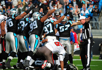 CHARLOTTE, NC - DECEMBER 24: Members of the Carolina Panthers signal after recovering a fumble by Josh Freeman #5 of the Tampa Bay Buccaneers at Bank of America Stadium on December 24, 2011 in Charlotte, North Carolina  (Photo by Scott Cunningham/Getty Im