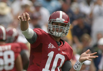 TUSCALOOSA, AL - SEPTEMBER 3:  Quarterback A.J. McCarron #10 of the Alabama Crimson Tide warms up during pre-game drills before the game with the Kent State Golden Flashes on September 3, 2011 at Bryant Denny Stadium in Tuscaloosa, Alabama.  Alabama defea