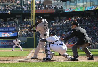 DETROIT, MI - APRIL 08:  David Ortiz #34 of the Boston Red Sox swings and makes contact in front of Alex Avila #13 of the Detroit Tigers during a MLB game at Comerica Park on April 8, 2012 in Detroit, Michigan.  The Tigers won 13-12 in extra innings  (Pho