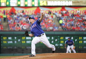 ARLINGTON, TX - APRIL 8: Matt Harrison #54 of the Texas Rangers throws against the Chicago White Sox at Rangers Ballpark in Arlington on April 8, 2012 in Arlington, Texas. (Photo by Rick Yeatts/Getty Images)