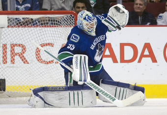 VANCOUVER, CANADA - MARCH 28: Goalie Cory Schneider #35 of the Vancouver Canucks makes a glove save against the Colorado Avalanche during the second period in NHL action on March 28, 2012 at Rogers Arena in Vancouver, British Columbia, Canada.  (Photo by