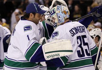 BOSTON, MA - JANUARY 07:  Roberto Luongo #1 congratulates Cory Schneider #35 of the Vancouver Canucks after the win over the Boston Bruins on January 7, 2012 at TD Garden in Boston, Massachusetts. The Vancouver Canucks defeated the Boston Bruins 4-3.  (Ph