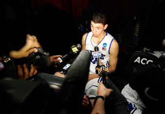 GREENSBORO, NC - MARCH 16:  Austin Rivers #0 of the Duke Blue Devils answers questions in the locker room after the Blue Devils lose to the Lehigh Mountain Hawks 75-70 during the second round of the 2012 NCAA Men's Basketball Tournament at Greensboro Coli
