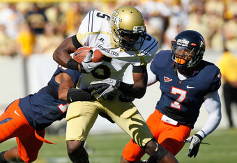 ATLANTA - OCTOBER 09:  Stephen Hill #5 of the Georgia Tech Yellow Jackets is tackled by Chase Minnifield #13 and Corey Mosley #7 of the Virginia Cavaliers at Bobby Dodd Stadium on October 9, 2010 in Atlanta, Georgia.  (Photo by Kevin C. Cox/Getty Images)