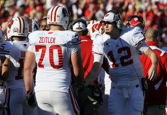 PASADENA, CA - JANUARY 02:  (R) Nate Tice #12 of the Wisconsin Badgers shakes hands with teammate Kevin Zeitler #70 as the Badgers take on the Oregon Ducks at the 98th Rose Bowl Game on January 2, 2012 in Pasadena, California.  (Photo by Stephen Dunn/Gett