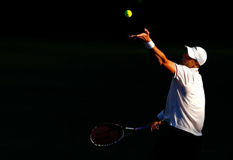 KEY BISCAYNE, FL - MARCH 23:  John Isner in action against Nikolay Davydenko of Russia during Day 5 of the Sony Ericsson Open at Crandon Park Tennis Center on March 23, 2012 in Key Biscayne, Florida.  (Photo by Mike Ehrmann/Getty Images)