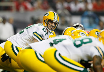 ATLANTA, GA - OCTOBER 09:  Aaron Rodgers #12 of the Green Bay Packers lines up behind his offensive line against the Atlanta Falcons at Georgia Dome on October 9, 2011 in Atlanta, Georgia.  (Photo by Kevin C. Cox/Getty Images)