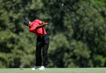 AUGUSTA, GA - APRIL 08:  Tiger Woods of the United States hits an approach shot on the fifth hole during the final round of the 2012 Masters Tournament at Augusta National Golf Club on April 8, 2012 in Augusta, Georgia.  (Photo by Andrew Redington/Getty I