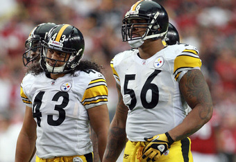 GLENDALE, AZ - OCTOBER 23: Troy Polamalu #43 and LaMarr Woodley #56 of the Pittsburgh Steelers look on at the Arizona Cardinals huddle during their game at University of Phoenix Stadium on October 23, 2011 in Glendale, Arizona.  (Photo by Karl Walter/Gett