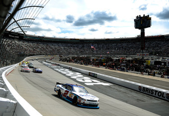 BRISTOL, TN - MARCH 17:  Elliott Sadler, driver of the #2 OneMain Financial Chevrolet, leads a pack of cars into turn one during the NASCAR Nationwide Series Ford EcoBoost 300 at Bristol Motor Speedway on March 17, 2012 in Bristol, Tennessee.  (Photo by J