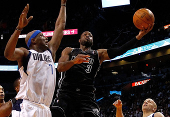 MIAMI, FL - MARCH 29:  Dwyane Wade #3 of the Miami Heat drives to the basket past Lamar Odom #7 of the Dallas Mavericks during a game at American Airlines Arena on March 29, 2012 in Miami, Florida. NOTE TO USER: User expressly acknowledges and agrees that