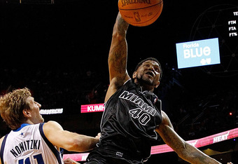 MIAMI, FL - MARCH 29: Udonis Haslem #40 of the Miami Heat dunks over Dirk Nowitzki #41 of the Dallas Mavericks during a game   at American Airlines Arena on March 29, 2012 in Miami, Florida. NOTE TO USER: User expressly acknowledges and agrees that, by do