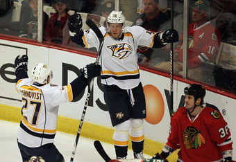 CHICAGO, IL - MARCH 25: (L-R) Patric Hornqvist #27 and Andrei Kostitsyn #46 of the Nashville Predators celebrate Kostitsyn's goal against Dave Bolland #36 and the Chicago Blackhawks at the United Center on March 25, 2012 in Chicago, Illinois. The Predator