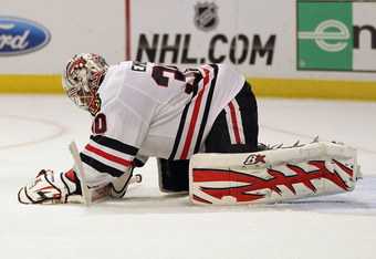 Ray Emery will return for another season as the Hawks' back-up goalie.