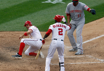 Zimmerman slides into home with the winning run in the 10th inning on Thursday.