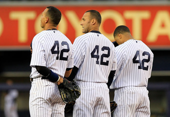 NEW YORK, NY - APRIL 15: (L-R) Alex Rodriguez, Derek Jeter and Robinson Cano of the New York Yankees wear #42 to commemorate Jackie Robinson day during the game against the Texas Rangers at Yankee Stadium on April 15, 2011 in the Bronx borough of New York