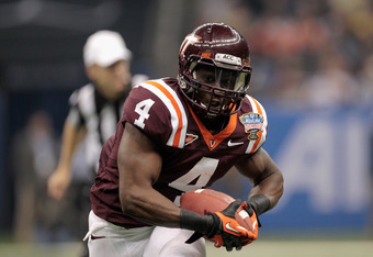 NEW ORLEANS, LA - JANUARY 03:  David Wilson #4 of the Virginia Tech Hokies runs the ball against the Michigan Wolverines during the Allstate Sugar Bowl at Mercedes-Benz Superdome on January 3, 2012 in New Orleans, Louisiana.  (Photo by Chris Graythen/Gett