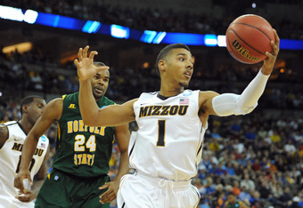 OMAHA, NE - MARCH 16:  Phil Pressey #1 of the Missouri Tigers attempts to control the ball against Brandon Wheeless #24 of the Norfolk State Spartans during the second round of the 2012 NCAA Men's Basketball Tournament at CenturyLink Center on March 16, 2