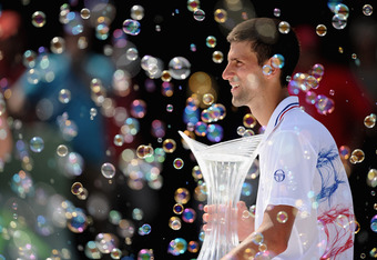 KEY BISCAYNE, FL - APRIL 01:  Novak Djokovic of Serbia holds the winner's trophy after beating Andy Murray of Great Britain in the men's singles final on day 14 of the Sony Ericsson Open at Crandon Park Tennis Center on April 1, 2012 in Key Biscayne, Flor
