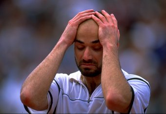 6 Jun 1999:  Andre Agassi of the United States celebrates victory and is overcome with emotions during the 1999 French Open Final match against Andrei Medvedev of the Ukraine played at Roland Garros in Paris, France.  The match finished in an emotional vi