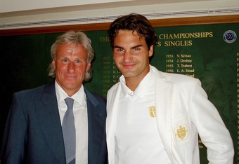 LONDON - JULY 8:  Men's singles champion Roger Federer (R) of Switzerland poses with former champion Bjorn Borg in the members area at the All England Lawn Tennis and Croquet Club following Federer's victory over Rafael Nadal of Spain in the Wimbledon Law