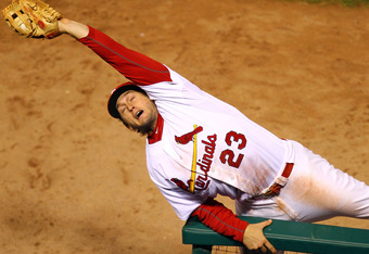 David Freese making a great catch in foul territory against the Texas Rangers in Game 7 of the 2011 World Series.