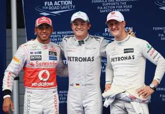 SHANGHAI, CHINA - APRIL 14:  Polesitter Nico Rosberg (C) of Germany and Mercedes GP celebrates with second placed Lewis Hamilton (L) of Great Britain and McLaren and third placed Michael Schumacher of Germany and Mercedes GP following qualifying for the C