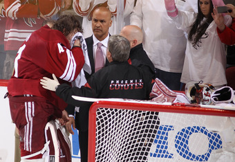 GLENDALE, AZ - APRIL 14:  Goaltender Mike Smith #41 of the Phoenix Coyotes is looked at by the team doctor after a hard collision with Andrew Shaw (not pictured) of the Chicago Blackhawks in the second period of Game Two of the Western Conference Quarterf