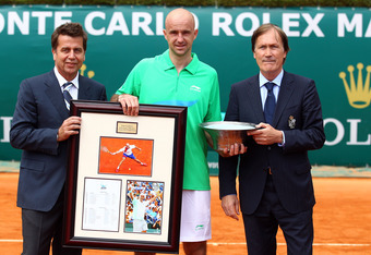 MONTE-CARLO, MONACO - APRIL 15:  ATP Chairman and President, Brad Drewett (L) and Zeljiko Franulovic, Tournament Director present gifts to Ivan Ljubicic of Croatia after retiring from the sport during day one of the ATP Monte Carlo Masters on April 15, 20