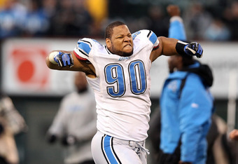 OAKLAND, CA - DECEMBER 18:  Ndamukong Suh #90 of the Detroit Lions celebrates after they came from behind to beat the Oakland Raiders at O.co Coliseum on December 18, 2011 in Oakland, California.  (Photo by Ezra Shaw/Getty Images)