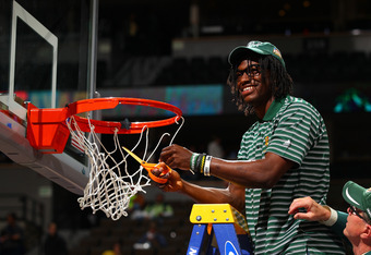 DENVER, CO - APRIL 03:  Heisman trophy winner and Baylor Bears quarterback Robert Griffin III cuts down a piece of the net in celebration of the Baylor Bears 80-61 win against the Notre Dame Fighting Irish during the National Final game of the 2012 NCAA D