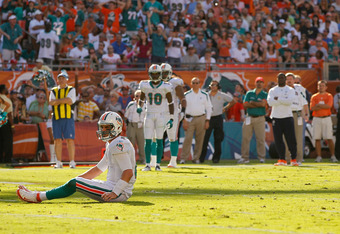 MIAMI GARDENS, FL - JANUARY 01:  Matt Moore #8 of the Miami Dolphins looks on during a game against the New York Jets at Sun Life Stadium on January 1, 2012 in Miami Gardens, Florida.  (Photo by Mike Ehrmann/Getty Images)