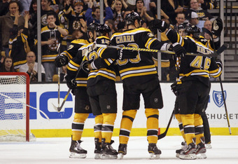BOSTON, MA - MARCH 19: Zdeno Chara #33 of the Boston Bruins scores on the powerplay at 5:45 of the second period against the Toronto Maple Leafs and is congratulated by teammates at the TD Garden on March 19, 2012 in Boston, Massachusetts.  (Photo by Bruc