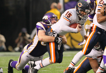 MINNEAPOLIS, MN - JANUARY 01:   Jared Allen #69 of the Minnesota Vikings sacks  Josh McCown #15 of the Chicago Bears to set a franchise record of 22 sacks for the season at the Hubert H. Humphrey Metrodome on January 01, 2012 in Minneapolis, Minnesota.  (