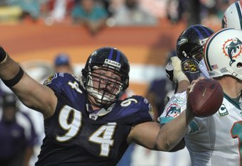 MIAMI, FL - JANUARY 4:  Defensive tackle Justin Bannan #94 of the Baltimore Ravens  rushes the pocket against the Miami Dolphins in an NFL Wildcard Playoff Game at Dolphins Stadium on January 4, 2009 in Miami, Florida.  (Photo by Al Messerschmidt/Getty Im