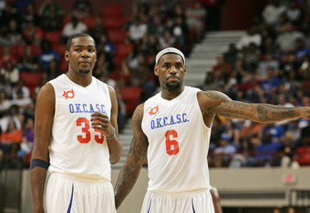 OKLAHOMA CITY, OK - OCTOBER 23:  Kevin Durant  and LeBron James of Team White talk during a timeout at the US Fleet Tracking Basketball Invitational charity basketball game October 23, 2011 at the Cox Convention Center in Oklahoma City, Oklahoma.  The gam