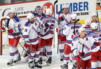 PITTSBURGH, PA - JANUARY 06:  Goaltender Henrik Lundqvist #30 of the New York Rangers is congratulated by teammates after defeating the Pittsburgh Penguins in the NHL game at Consol Energy Center on January 6, 2012 in Pittsburgh, Pennsylvania. The Rangers