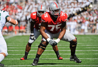 COLUMBUS, OH - SEPTEMBER 18:  Mike Adams #75 of the Ohio State Buckeyes looks for his blocking assignment against the Ohio Bobcats at Ohio Stadium on September 18, 2010 in Columbus, Ohio.  (Photo by Jamie Sabau/Getty Images)