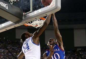 NEW ORLEANS, LA - APRIL 02:  Tyshawn Taylor #10 of the Kansas Jayhawks puts up a shot over Michael Kidd-Gilchrist #14 of the Kentucky Wildcats in the National Championship Game of the 2012 NCAA Division I Men's Basketball Tournament at the Mercedes-Benz S
