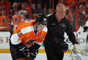 PHILADELPHIA, PA - APRIL 15:  Brayden Schenn #10 of the Philadelphia Flyers leaves the ice after an injury in the game against the Pittsburgh Penguins in Game Three of the Eastern Conference Quarterfinals during the 2012 NHL Stanley Cup Playoffs at Wells