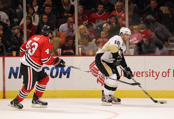 CHICAGO, IL - SEPTEMBER 30:  James Neal #18 of the Pittsburgh Penguins controls the puck against Brandon Saad #43 of the Chicago Blackhawks during a preseason game at the United Center on September 30, 2011 in Chicago, Illinois. The Penguins defeated the