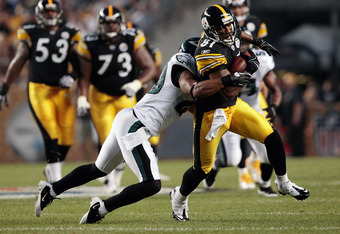 PITTSBURGH - AUGUST 18:  Arnaz Battle #81 of the Pittsburgh Steelers attempts to break a tackle from Nate Allen #29 of the Philadelphia Eagles after catching a pass during the preseason game on August 18, 2011 at Heinz Field in Pittsburgh, Pennsylvania.