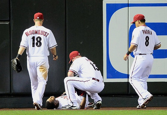 Chris Young waits for trainers after crashing into the outfield wall Tuesday night. (Mark J. Rebilas-US PRESSWIRE)
