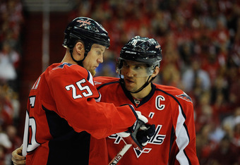 WASHINGTON, DC - APRIL 16:  Alex Ovechkin #8 talks with Jason Chimera #25 of the Washington Capitals during the first period against the Boston Bruins in Game Three of the Eastern Conference Quarterfinals during the 2012 NHL Stanley Cup Playoffs at Verizo