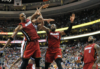 PHILADELPHIA, PA - MARCH 16:  Chris Bosh #1, Dwyane Wade #3 and LeBron James #6 of the Miami Heat try for a rebound during the game against the Philadelphia 76ers at the Wells Fargo Center on March 16, 2012 in Philadelphia, Pennsylvania. The Heat won 84-7
