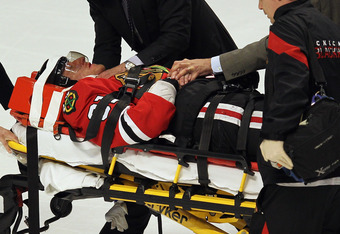 Marion Hossa leaves the ice after leveled by Raffi Torres in  Game Three.