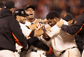 SAN FRANCISCO, CA - APRIL 18:  The San Francisco Giants surround Melky Cabrera #53 after he hit the game winning hit that scored Brandon Belt #9 in the 11th inning of their game against the Philadelphia Phillies at AT&T Park on April 18, 2012 in San Franc