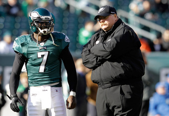 PHILADELPHIA, PA - JANUARY 01:  Michael Vick (7) of the Philadelphia Eagles talks with head coach Andy Reid before the start of the Eagles game against the Washington Redskins at Lincoln Financial Field on January 1, 2012 in Philadelphia, Pennsylvania.  (